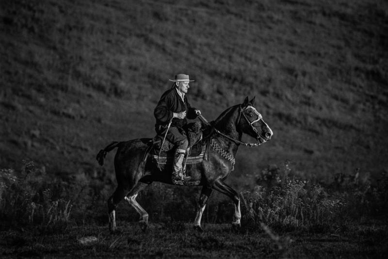 At dawn a gaucho riding his criollo horse. Uruguay, 2005