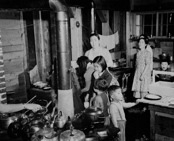 Japanese-Canadian women and children prepare a meal in the community kitchen at Greenwood internment camp, British Columbia, 1943. Library and Archives Canada