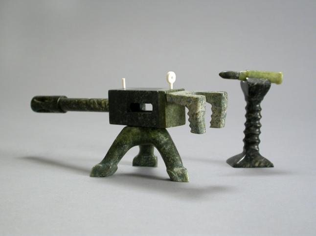 Machine Gun, 2006, stone & ivory, 3.25 x 7.25 x 3 in. (gun), 3 x 2.25 x 1.25 in. (bullet)
