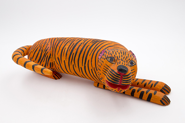 Tiger; Manuel Jimenez (dates unknown); Oaxaca, Mexico; c. 1980; paint on wood; 5 x 18 x 8 in.; gift of Elizabeth F. Wecter, Animal Carnival, Inc., IR85.53.1. Photo by American Folk Art Museum.