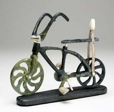 My First Bike serpentine, ivory, antler, slate base Size: 6.75 × 8 × 2.25 inches